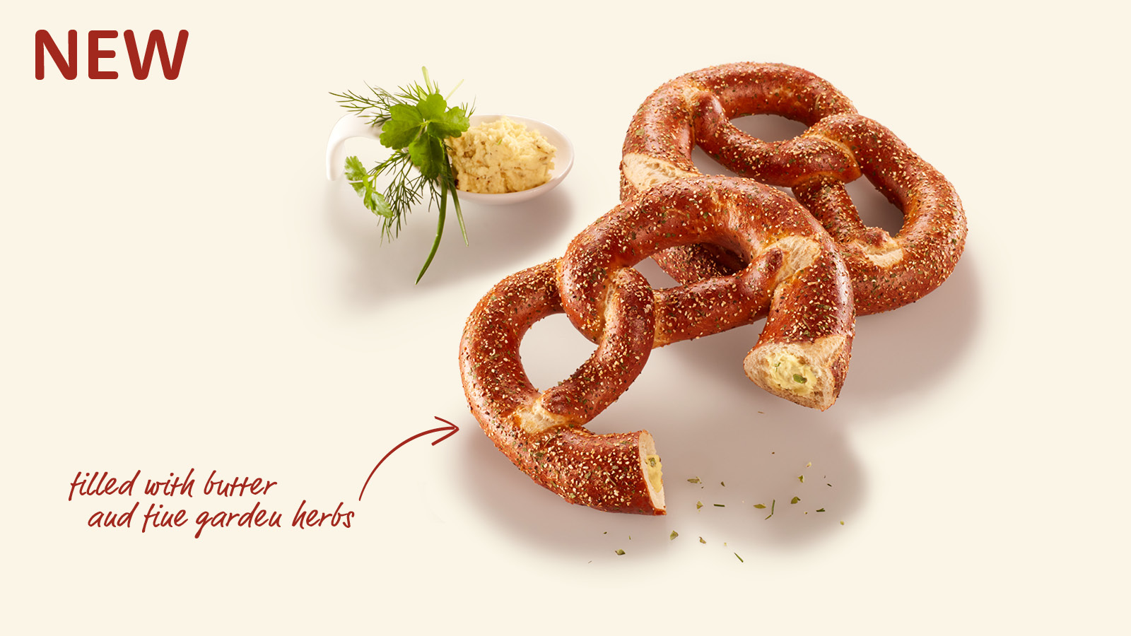 Pretzel filled with butter and fine garden herbs